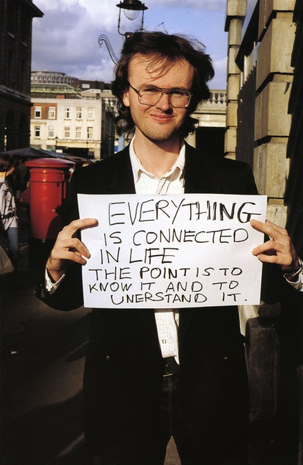 "Gillian Wearing, <i>Signs that say what you want them to say and not Signs that say what someone else wants you to say</i>, ""EVERYTHING IS CONNECTED IN LIFE THE POINT IS TO KNOW IT AND TO UNDERSTAND IT,"" 1992-3. C-type print. © the artist, courtesy Maureen Paley, London."