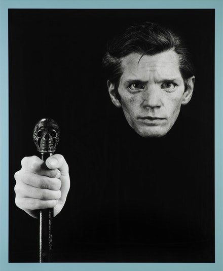 "Gillian Wearing, ""Me As Mapplethorpe,"" 2009. Based upon the Robert Mapplethorpe work: Self Portrait, 1988. © Robert Mapplethorpe Foundation. Framed bromide print. 62 5/8 x 51 5/8"". © the artist, courtesy Maureen Paley, London."