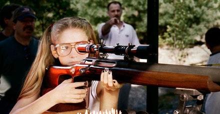 <i>A Girl and A Gun</i>, photo by Cathryne Czubek.