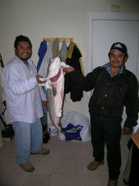 Enrique (left) and his brother, Angel, showing off the catch of a luckier expedition.  Photos by Gabriel Thompson