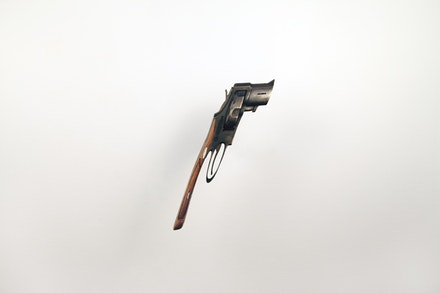 "Robert Lazzarini, ""Gun (v),"" 2008. Steel, walnut, 105. x 6.5 x 3"". Image courtesy of the artist."