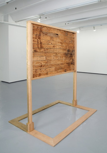 "Tyler Rowland, ""The Floor Scrapers,"" 2006-2012, ongoing. Painted floorboards, red oak, and gold paint. 83 x 69 x 51"". Courtesy of Tyler Rowland and Jack Shainman Gallery, New York."