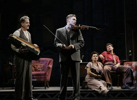 Tony Shalhoub, Seth Numrich, Dagmara Dominczyk, and Michael Aronov in a scene from Lincoln Center Theater&#146;s 75th Anniversary production of <i>Golden Bo</i> by Clifford Odets, directed by Bartlett Sher at the Belasco Theatre (111 W. 44 St.). Photo: Paul Kolnik.