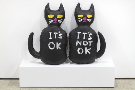 "David Shrigley, ""Cats (It's OK, It's Not OK),"" 2012. Acrylic on canvas stuffed with foam. 17 1/2 x 10 1/2 x 4 1/2"". Courtesy Anton Kern Gallery, New York."