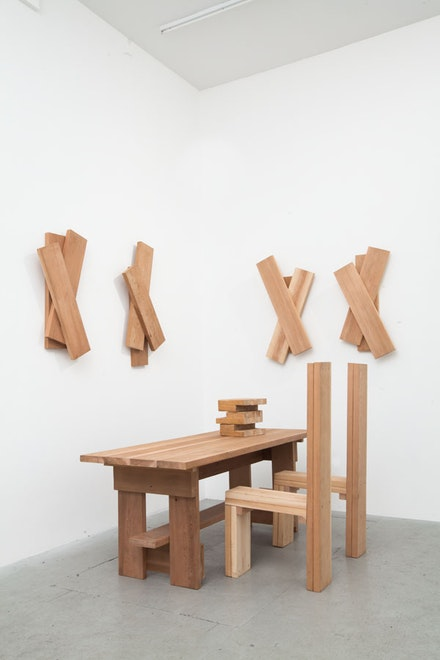 "Richard Nonas, ""Untitled (Table, 2 Chairs, 4 wall pieces),"" 2011. Cedar wood. Dimensions variable. Unique. Courtesy of the artist and James Fuentes."