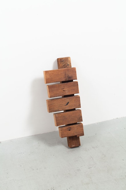 "Richard Nonas, ""NY Storm Cracked Wood (Wall black walnut),"" 2013. Wood. 24 x 4.25 x 4.25"". Courtesy of the artist and James Fuentes."