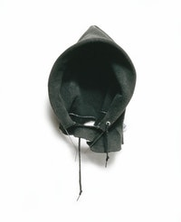 "David Hammons, ""In the Hood,"" 1993. Athletic sweatshirt hood with wire, 23 x 10 x 5"". Collection Connie and Jack Tilton, New York."