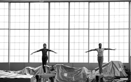 In the 1930s pioneers such as Howard Hughes and Amelia Earhart took off in flight from this revamped hangar. Today gymnasts in training learn aerial flips a little closer to the ground.