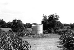 "Alice Aycock, ""Project for a Circular Building with Narrow Ledges for Walking,"" 1976. Reinforced concrete, cast in place; 12' diameter x 17' high. Originally sited at Silver Springs, Pennsylvania (destroyed). Photo: Artist."