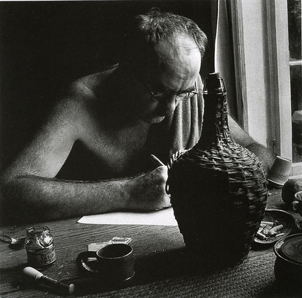 Charles Olson, Black Mountain College, 1951, Writing The Maximus Poems. Photograph by Jonathan Williams. Collection of Jonathan Williams.
