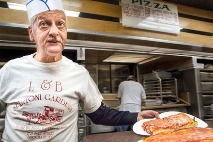 If there is anyone you don't want to be on bad terms with in Bensonhurst, it's the man who slices the trays at L&B's. A summer in Brooklyn is incomplete without devouring at least a dozen Sicilian squares and twice as many spumoni ices.