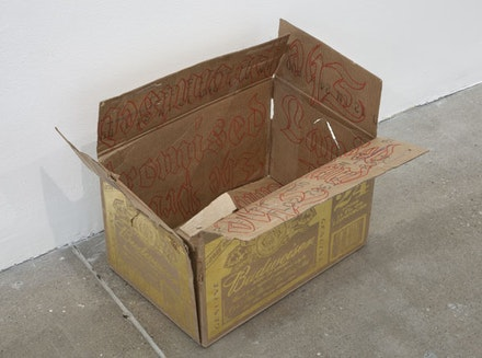 "Danh Vo, ""Promised Land,"" 2013. Gold, ink and cardboard, 14 x 19 x 15"". Courtesy of the artist and Marian Goodman Gallery, New York."