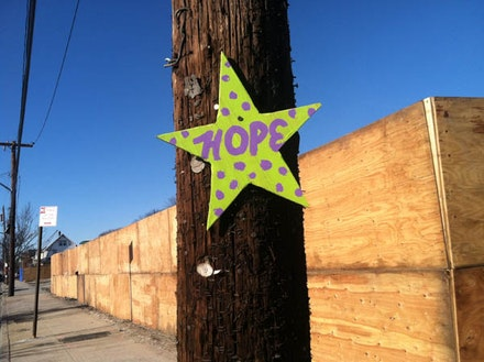 A volunteer group who helped with the relief effort in the Rockaways after Hurricane Sandy nailed stars with one-word messages like hope and community and love to telephone poles throughout the Rockaways. This one is located at the corner of Beach 130th Street and Newport Avenue. Photo by Amanda Waldroupe.