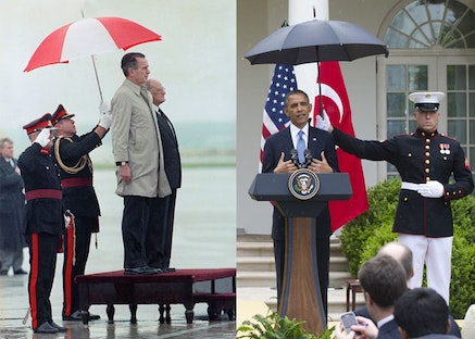 L to R: President George H.W. Bush, under umbrella wearing light coat, reviews honor guard on his arrival to for his summit with Soviet President Gorbachev in Luga, Malta Dec. 1, 1989. With Bush at right is president of Malta, Dr. Vincent Tabona. Others are unidentified. (AP Photo/Doug Mills); Marine holding an umbrella over President Obama at a joint press conference with Turkish Prime Minister Recep Erdogan, May 16, 2013. (Photo: SAUL LOEB/AFP/Getty Images).