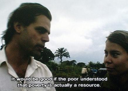 Film stills from <i>Episode III: Enjoy Poverty</i> (90 min., 2008).