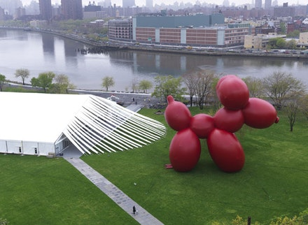 "Paul McCarthy, ""White Snow, Balloon Dog (red),"" 2013. Vinyl-coated nylon, fans, rigging. 2438 x 1917 1/4 x 1045 1/2"". Installation view, Frieze New York Sculpture Park, Randall's Island, New York NY. Courtesy the artist and Hauser & Wirth. Photo: Genevieve Hanson."