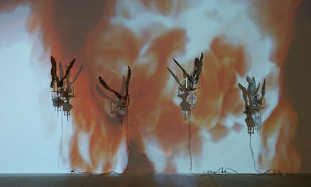 Carolee Schneemann, <i>Flange 6rpm</i>. Foundry poured aluminum sculptures, motors 6rpm each unit; DVD projections floor to ceiling of foundry firing. Photo: Susan Alzner.