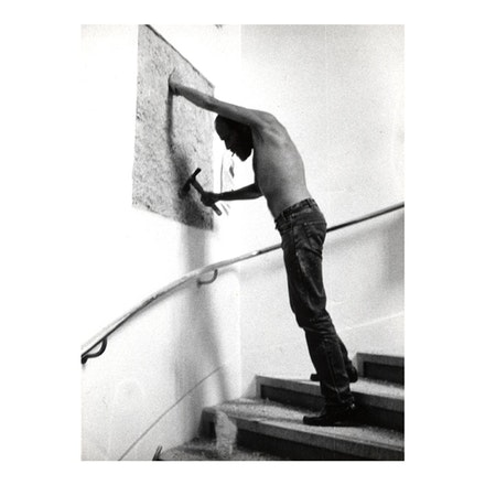 """A 36"" X 36"" REMOVAL TO THE LATHING OR SUPPORT WALL OF PLASTER OR WALLBOARD FROM A WALL,"" 1968. LANGUAGE + THE MATERIALS REFERRED TO. Weiner constructing the work for <i>When Attitudes Become Form</i>, Kunsthalle Bern, Switzerland, 1969. Photo: Shunk-Kender."