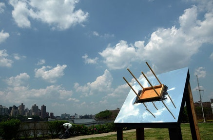 """Instruction by Darren Bader, """"Glue a [rectangular] table to the sky [table top up, somewhere not too close to the sky's zenith]"""" 2012. Interpreted by Grayson Revoir. 12 x 8 x 8', Wood, plexi mirror, tar. Photo: Nate Dorr."""