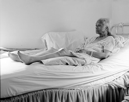"LaToya Ruby Frazier, ""Grandma Ruby On Her Bed,"" 2007. Silver Gelatin Print 20 x 24"". All artworks courtesy of LaToya Ruby Frazier © LaToya Ruby Frazier."