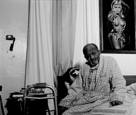 "LaToya Ruby Frazier, ""Gramps On His Bed,"" 2003. Silver Gelatin Print, 20 x 24"". All artworks courtesy of LaToya Ruby Frazier © LaToya Ruby Frazier."