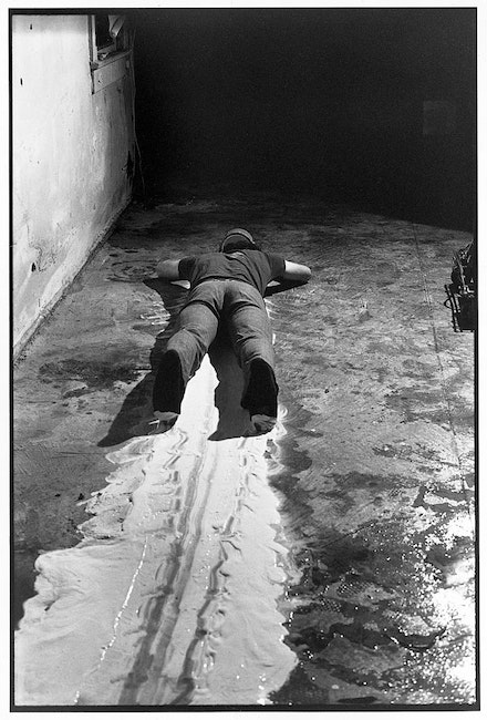 "Paul McCarthy, ""Face Painting Floor, White Line,"" 1872, from <i>Black and White Tapes</i>, 1970-75. Video: black and white; sound; 32.50 min."