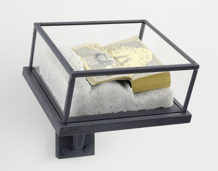"Matthew Barney, ""Ancient Evenings: Ba Libretto,"" 2009. Ink, graphite and gold leaf on paperback copy of Ancient Evenings by Norman Mailer, on carved salt base, in nylon and acrylic vitrine, 15 1/2 x 13 3/4 x 14 3/4"". Photo: David Regen. Copyright Matthew Barney. Courtesy Gladstone Gallery, New York and Brussels."