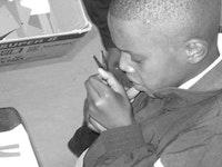 Vuyo Mkalipi using scissors. Photo courtesy of Sandra Edmonds.