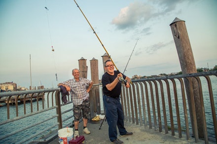 Tahir and his friend, both local Turks, fish off the pier for Lafayettes, while larger fishing boats head out to catch Blues and Bass. It has been a slow year, but they keep faith that as the tide comes in so will the fish.
