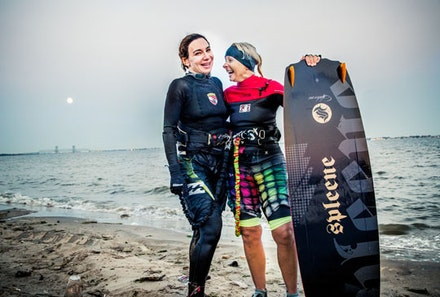 Luba, left, takes kite surfing lessons from Nina, right, who despite her SoCal look is actually a Russian gal who teaches daring Brooklynites how to navigate the winds under the Belt Parkway in Plum Beach.