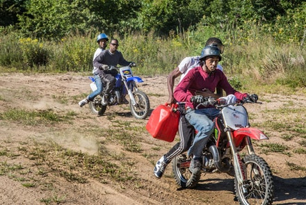 On tracks built into the dunes of Gerritsen Beach, teens drive dirtbikes with precision, fearlessly racing across the sand.