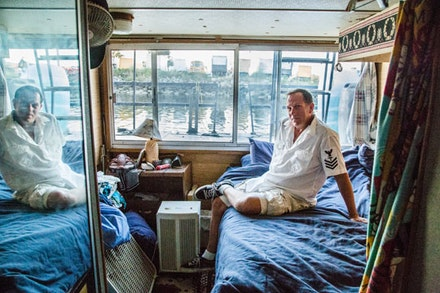 Darren, better known by his neighbors as Captain Seaweed, spent his life in different cities surrounded by water, before settling into his house boat on the bay.