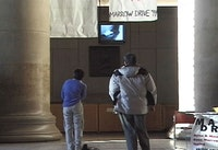 """Lobby 7"" 1999. Performance and Documentation Video, 7min. Courtesy Jill Magid and Galerie Yvon Lambert, Paris."