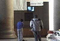 """Lobby 7"" 1999. Performance and Documentation Video, 7min. Courtesy Jill Magid and Galerie Yvon Lambert, Paris."