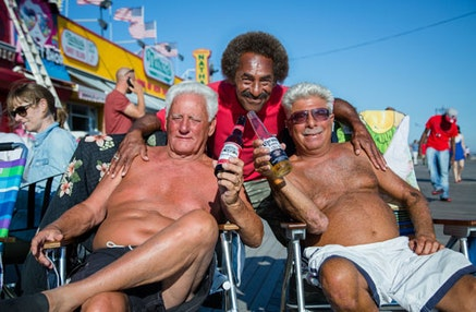 Johnny Corona, Harry D., and Frankie Oil bring their beach chairs to sit outside Ruby's Bar in Coney Island, and have been known to drink out there with snow on their heads.