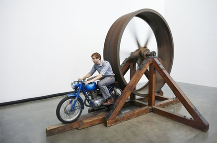 """""""The Big Wheel"""" 1979. Three-ton, eight-foot diameter, cast-iron flywheel powered by a 1968 Benelli 250cc motorcycle. 112 × 175 × 143 in. Courtesy New Museum, New York. Photo: Benoit Pailley."""