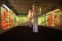 "Nalini Malani's installation ""In Search of Vanished Blood"" 2012, six-channel video/shadow play with five rotating reverse painted Mylar cylinders, sound, 11 minutes, total dimensions variable, edition of 3; at Lelong, © Nalini Malani, Courtesy of Galerie Lelong, New York."