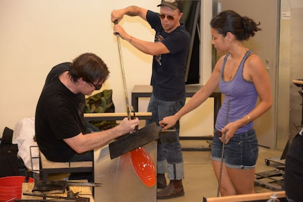 Artists at work blowing glass In UrbanGlass's newly renovated studios. Credit: UrbanGlass.