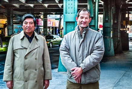 Two friends from Uzbekistan and Kazakhstan plan to drink Vodka surreptitiously underneath the elevated platforms at Sheepshead Bay.
