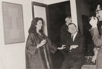 The artist with Iris Clert at the opening of his exhibition at Galerie Iris Clert, in Paris, June 1963.