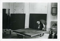 Ad Reinhardt painting in studio, New York, 1962. Copyright Marvin Lazarus.