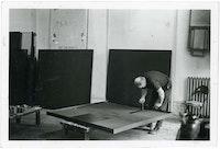 Ad Reinhardt painting in studio, New York, 1962. Copyright Marvin Lazarus.
