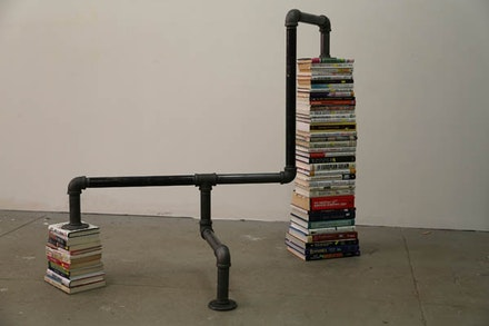 "G.T. Pellizzi, ""Financial Times (Diagram, Figure 3)."" 2013. Books, steel pipe, 44 × 50 × 30˝.  Courtesy Mary Boone Gallery, New York."