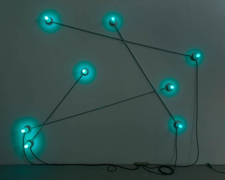 "G.T. Pellizzi, ""Constellation in Blue (Figure 2).� 2013. Light bulbs/porcelain, steel, wire, 108 × 132�.  Courtesy Mary Boone Gallery, New York."