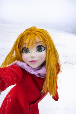 """Laurie Simmons, """"Yellow Hair/Red Coat/Snow/Selfie,"""" 2014. 20 × 28.75 inches."""