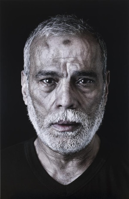 "Shirin Neshat, ""Ahmed (from ""Our House Is on Fire"")"", 2013. Digital C-print and ink. 621/8 × 401/4 ̋. Courtesy of Gladstone Gallery."