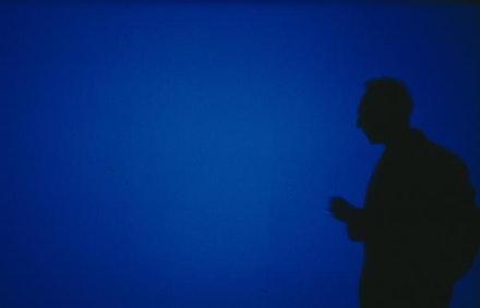 Derek Jarman at a live performance of <em>Blue</em>, 1993.