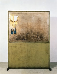 "Joseph Beuys, ""Gefängnis (Kabir + Daktyl) (Prison [Cabir + Dactyl]) (1983). Steel tubing, sheet metal, Plexiglas, two carbide lamps, lacquer, stone, and tape. 76 ½"" x 56 ½"" x 15 ¾"". Titled, ""Kabir"" and ""Daktyl,"" respectively, on each carbide lamp; signed and dated on top right, recto on iron rack: ""Joseph Beuys 17.4.1983"". Photo: Ellen Page Wilson, Courtesy Zwirner & Wirth, NY."