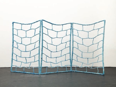 "Kathleen Ryan, ""Block Wall,"" 2012. Glazed ceramic, steel, 72 x 140 x 24 in. Courtesy of the artist."