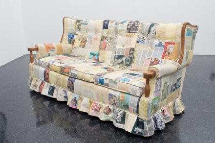 """The Couch,"" 2010. Romance novels and gay erotica printed on cotton, quilting, upholstery, found couch, 35 × 35 × 72 ̋. Photo: Terry Brown."